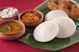 food South Indian food idli vada with sambar on a banana leaf